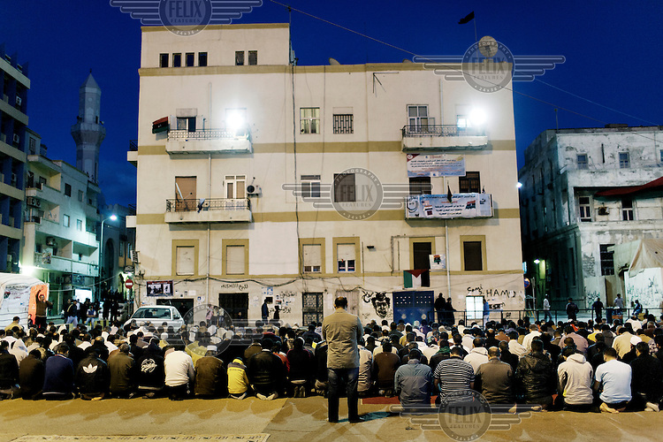 Every evening big crowds gather at the square next to the courthouse, the rebel headquarters. They have renamed the place Freedom Square. Men pray together. On 17 February 2011 Libya saw the beginnings of a revolution against the 41 year regime of Col Muammar Gaddafi..