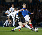 Kevin Holt makes a last ditch tackle to win the ball from Barrie McKay