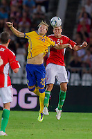 Sweden's Ola Toivonen (2nd R) and Hungary's Zsolt Korcsmar (R) go for a header during the UEFA EURO 2012 Group E qualifier Hungary playing against Sweden in Budapest, Hungary on September 02, 2011. ATTILA VOLGYI