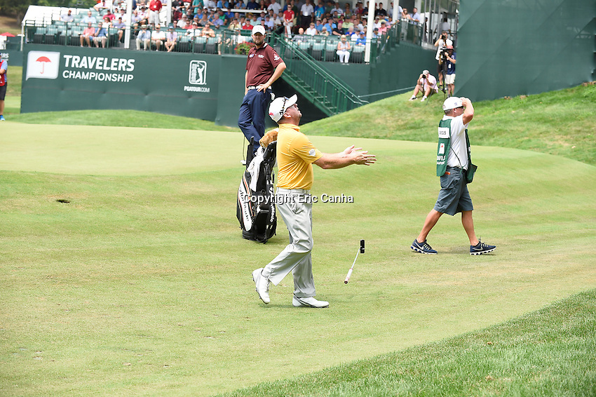 August 6, 2016: Robert Garrigus reacts to his ball bouncing off the hole flag post in the 15th green during day three of the PGA Travelers Championship held at TPC River Highlands in Cromwell CT. Eric Canha/CSM