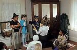 Oakland CA  Third grade field trip to historic home, trying on 19th century undergarments