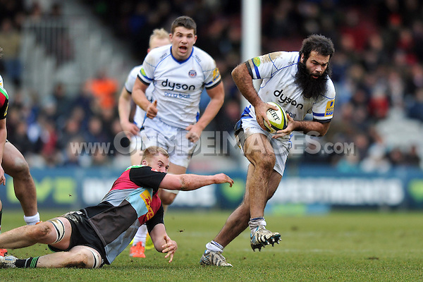 Kane Palma-Newport of Bath Rugby takes on the Harlequins defence. LV= Cup match, between Harlequins and Bath Rugby on January 31, 2015 at the Twickenham Stoop in London, England. Photo by: Patrick Khachfe / Onside Images