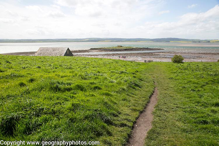 Path over filed to the coast, Holy Island, Lindisfarne, Northumberland, England, UK