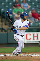 Round Rock Express outfielder Bryan Petersen #7 follows through on his swing during the Pacific Coast League baseball game against the Memphis Redbirds on April 24, 2014 at the Dell Diamond in Round Rock, Texas. The Express defeated the Redbirds 6-2. (Andrew Woolley/Four Seam Images)