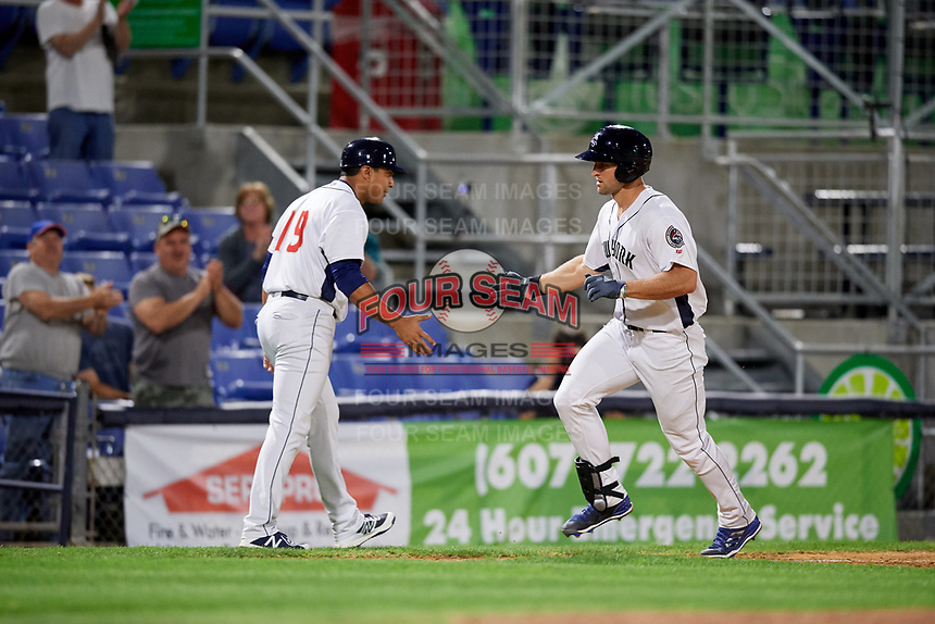 Binghamton Rumble Ponies left fielder Tim Tebow (15) is congratulated by manager Luis Rojas (19) as he rounds third base after hitting a sixth inning home run during a game against the Erie SeaWolves on May 14, 2018 at NYSEG Stadium in Binghamton, New York.  Binghamton defeated Erie 6-5.  (Mike Janes/Four Seam Images)