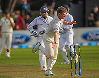 Jimmy Neesham attempts a run out during day one of the 2nd cricket test match between the New Zealand Black Caps and Sri Lanka at the Hawkins Basin Reserve, Wellington, New Zealand on Saturday, 3 February 2015. Photo: Dave Lintott / lintottphoto.co.nz