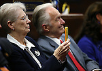 Janet Heller talks a photo as her son U.S. Sen. Dean Heller speaks to the Nevada Legislature, in Carson City, Nev., on Monday, April 6, 2015. Her husband Jack is at right.<br /> Photo by Cathleen Allison