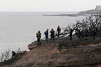 Pictured: Firemen examine the area where 26 bodies were discovered in the aftermath of the wild forest fires in the Mati area near Rafina, Greece. Tuesday 24 July 2018<br /> Re: Deaths caused by wild forest fires throughout Greece.