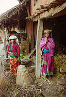 Namaste welcome greeting from women in traditional clothing at home in the foothills of the Himalayas at Pokhara in Nepal