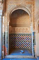 Arabesque Moorish architectural details of the Palacios Nazaries Alhambra. Granada, Andalusia, Spain.