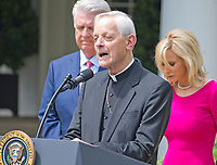 "Cardinal Donald Wuerl, the archbishop of Washington offers a prayer prior to United States President Donald J. Trump signing a Proclamation designating May 4, 2017 as a National Day of Prayer and an Executive Order ""Promoting Free Speech and Religious Liberty"" in the Rose Garden of the White House in Washington, DC on Thursday, May 4, 2017. Photo Credit: Ron Sachs/CNP/AdMedia"