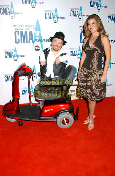 "TWO FOOT FRED & SARAH STONE from ""The Bachelor"".Arrivals - 40th Annual CMA Awards held at Gaylord Entertainment Center, Nashville, Tennessee, USA, .06 November 2006..full length elecrtic wheelchair .Ref: ADM/LF.www.capitalpictures.com.sales@capitalpictures.com.©Laura Farr/AdMedia/Capital Pictures. *** Local Caption *** ."
