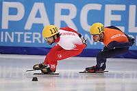 "SHORT TRACK: MOSCOW: Speed Skating Centre ""Krylatskoe"", 15-03-2015, ISU World Short Track Speed Skating Championships 2015, Semifinals 1000m Men, Charles HAMELIN (#110 | CAN), Sjinkie KNEGT (#148 | NED), ©photo Martin de Jong"
