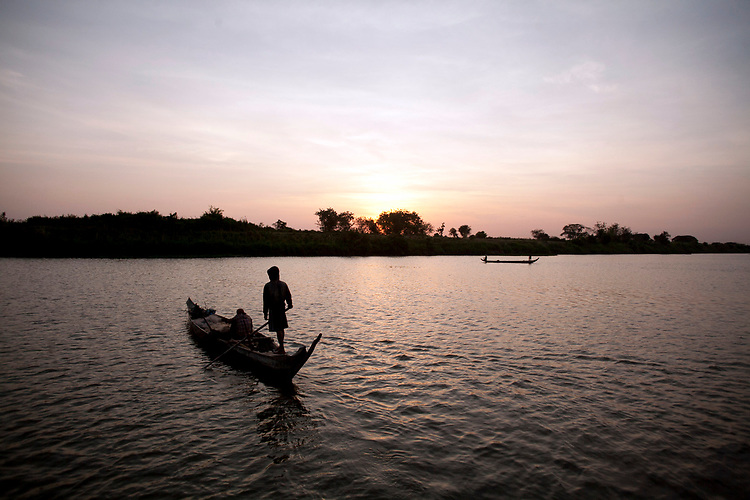 Fisherman work the Mekong River early in the morning outside of Phnom Penh, Cambodia. <br /> <br /> Photos &copy; Dennis Drenner 2013.
