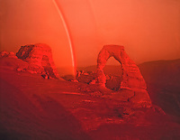 Rainbow at Delicate Arch Arches National Park, Utah   Free standing arch of Entrada sandstone