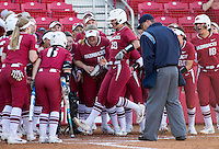 NWA Democrat-Gazette/JASON IVESTER<br /> Arkansas players congratulate Nicole Schroeder (29) as she crosses the plate Friday, March 3, 2017, after Schroeder's two-run home run in the fourth inning against Nebraska at Bogle Park in Fayetteville.