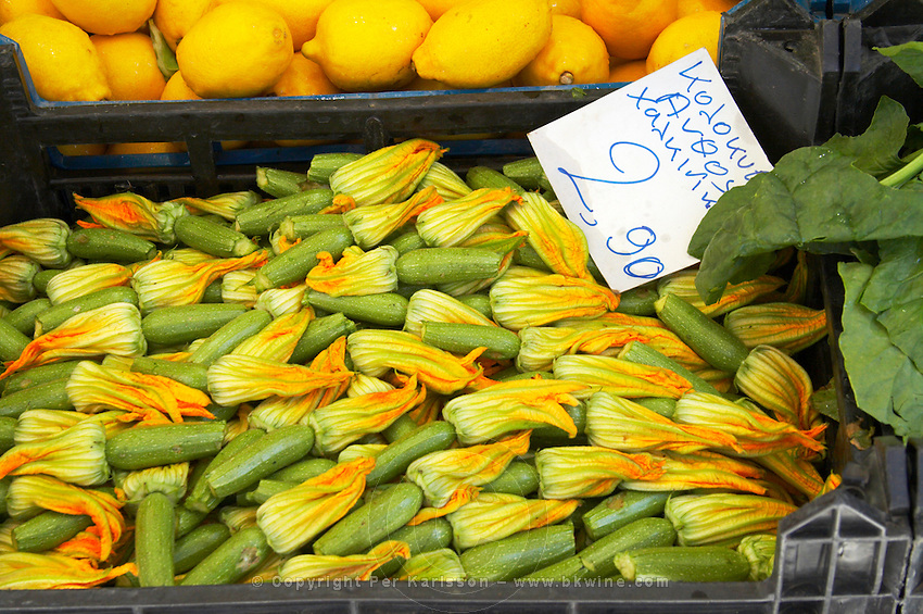 On a street market. Fruit and vegetable stands. Zucchini squash with flower. Thessaloniki, Macedonia, Greece