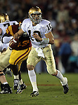 Los Angeles, CA 11/25/06 - Brady Quinn, with USC's Sedrick Ellis in pursuit, scrambles to find an open receiver, only to run for a gain of a few yards before being tackled.<br />
