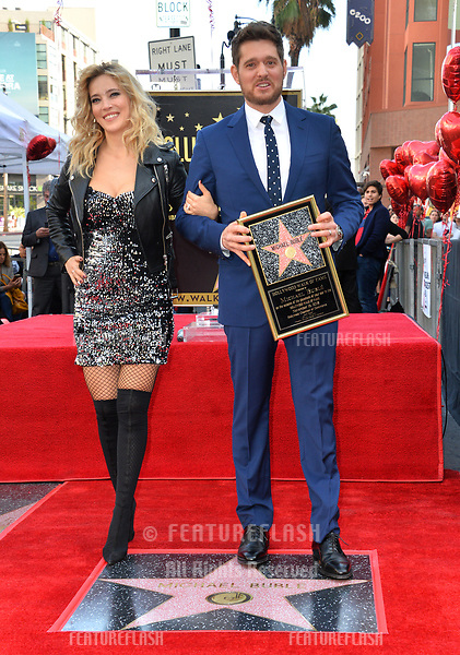 LOS ANGELES, CA. November 16, 2018: Michael Buble & Luisana Lopilato at the Hollywood Walk of Fame Star Ceremony honoring singer Michael Bublé.<br /> Pictures: Paul Smith/Featureflash