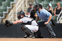 Kannapolis Intimidators catcher Casey Schroeder (17) sets a target as home plate umpire Zach Neff looks on during the game against the West Virginia Power at Kannapolis Intimidators Stadium on June 18, 2017 in Kannapolis, North Carolina.  The Intimidators defeated the Power 5-3 to win the South Atlantic League Northern Division first half title.  It is the first trip to the playoffs for the Intimidators since 2009.  (Brian Westerholt/Four Seam Images)
