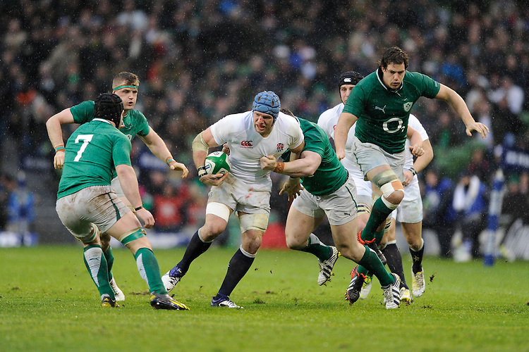 James Haskell of England is tackled during the RBS 6 Nations match between Ireland and England at the Aviva Stadium, Dublin on Sunday 10 February 2013 (Photo by Rob Munro)