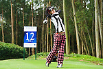 Mai Arai of Japan tees off during the 2011 Faldo Series Asia Grand Final on the Faldo Course at Mission Hills Golf Club in Shenzhen, China. Photo by Raf Sanchez / Faldo Series