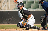 Catcher John Curtis (35) of the Kannapolis Intimidators drops to his knees to block a low pitch at Fieldcrest Cannon Stadium in Kannapolis, NC, Sunday May 25, 2008.