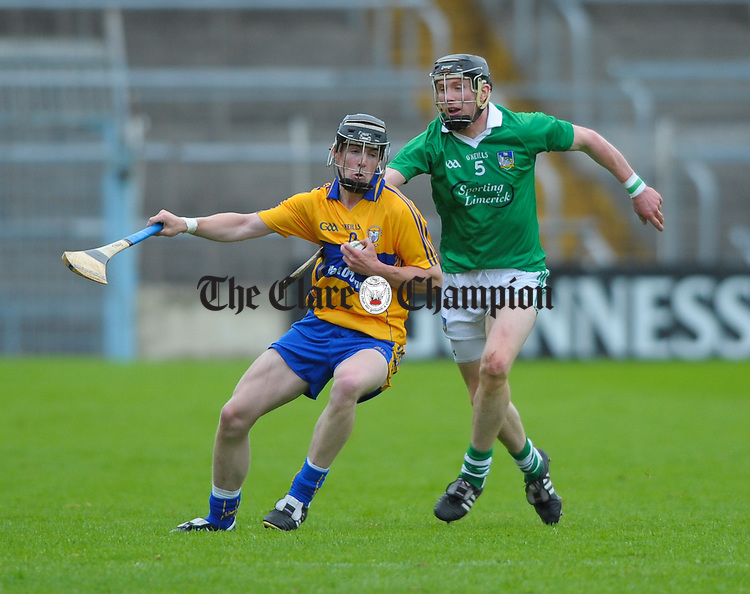 Tony Kelly of Clare in action against Wayne Mc Namara of Limerick during their game at Semple Stadium. Photograph by John Kelly.