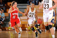 28 January 2012:  FIU guard Jerica Coley (22) is pursued by WKU guard Ellen Sholtes (11) while handling the ball in the second half as the FIU Golden Panthers defeated the Western Kentucky University Hilltoppers, 60-56, at the U.S. Century Bank Arena in Miami, Florida.  Coley, who has scored the second-most points of any women's player in the country, finished the game with 36 points and surpassed the 1,000 point mark.