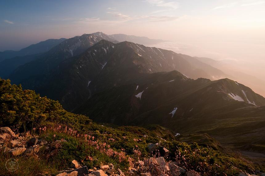 Daybreak from the summit of Mount Goryu, looking past Mount Karamatsu to Mount Shirouma.