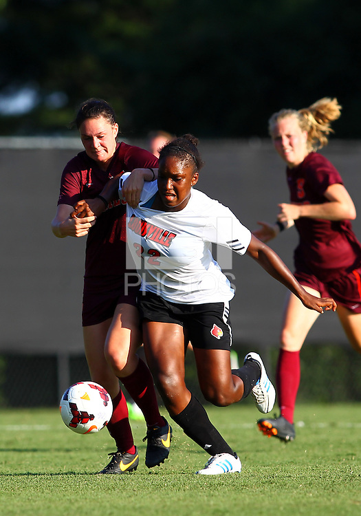 WINSTON-SALEM, NORTH CAROLINA - August 30, 2013:<br />  Christine Exeter (22) of Louisville University struggles to get away from Jordan Coburn (19) of Virginia Tech during a match at the Wake Forest Invitational tournament at Wake Forest University on August 30. The game ended in a 1-1 tie.