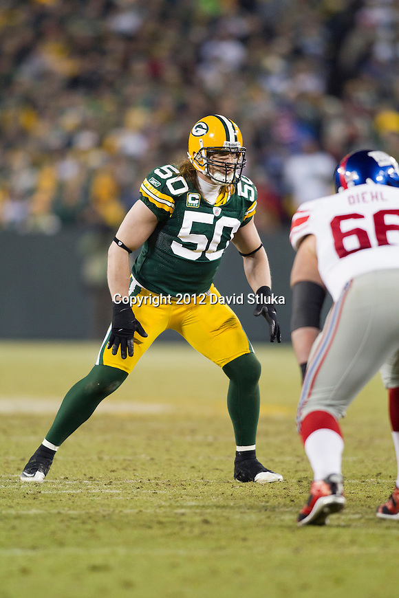 Green Bay Packers linebacker A.J. Hawk (50) plays defense during an NFL divisional playoff football game against the New York Giants on January 15, 2012 in Green Bay, Wisconsin. The Giants won 37-20. (AP Photo/David Stluka)