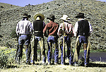 Five cowboys posing with their backsides in Oregon.