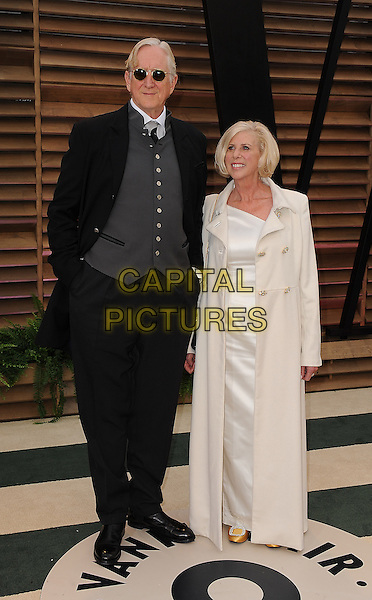 WEST HOLLYWOOD, CA - MARCH 2: T. Bone Burnett, Callie Khouri  arrives at the 2014 Vanity Fair Oscar Party in West Hollywood, California on March 2, 2014. <br /> CAP/MPI/MPI213<br /> &copy;MPI213 / MediaPunch/Capital Pictures