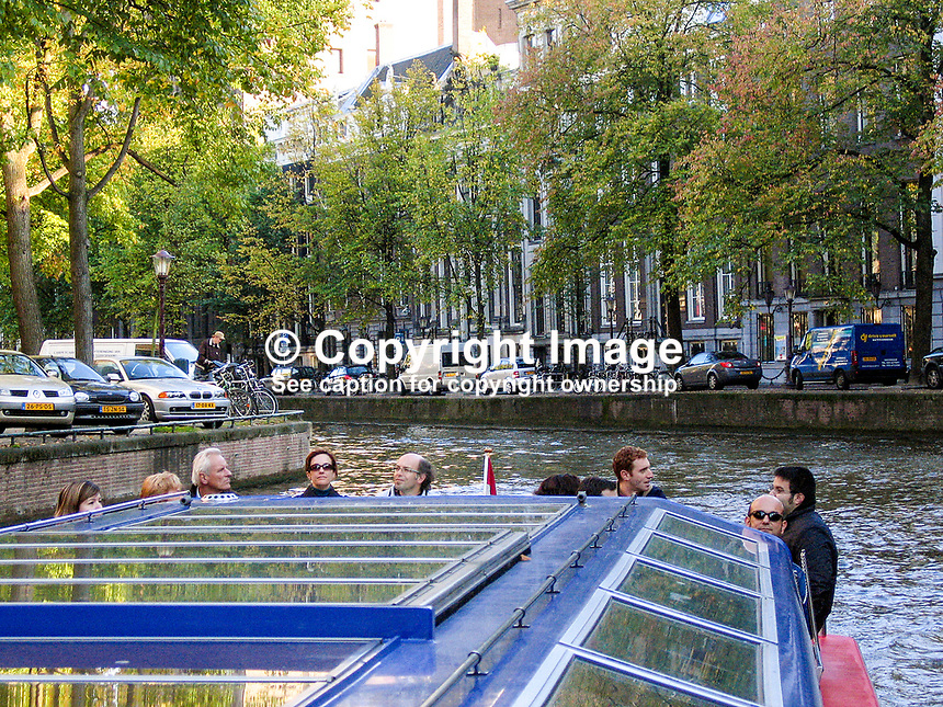 Cruising, canal cruise, canal, Amsterdam, Holland, Netherlands,200710050117..Copyright Image from Victor Patterson, 54 Dorchester Park, Belfast, UK, BT9 6RJ..Tel: +44 28 9066 1296.Mob: +44 7802 353836.Voicemail +44 20 8816 7153.Skype: victorpattersonbelfast.Email: victorpatterson@mac.com.Email: victorpatterson@ireland.com (back-up)..IMPORTANT: If you wish to use this image or any other of my images please go to www.victorpatterson.com and click on the Terms & Conditions. Then contact me by email or phone with the reference number(s) of the image(s) concerned.