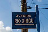 """Pará State, Brazil. São Félix do Xingu. Peeling roadsign; """"Avenida Rio Xingu""""."""