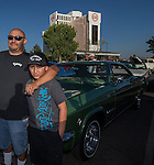 Brian and 11 year old Christian Gerardo with their 1965 green Chevy Impala during Hot August Nights at the Grand Sierra Resort on Tuesday, August 2, 2016.