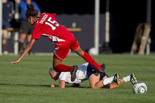Wisconsin forward Cara Walls (#15) is tripped up by Notre Dame defender Kecia Morway (#16) in action during NCAA Women's soccer match between Wisconsin and Notre Dame.  The Notre Dame Fighting Irish defeated the Wisconsin Badgers 2-0 in match at Alumni Field in South Bend, Indiana.
