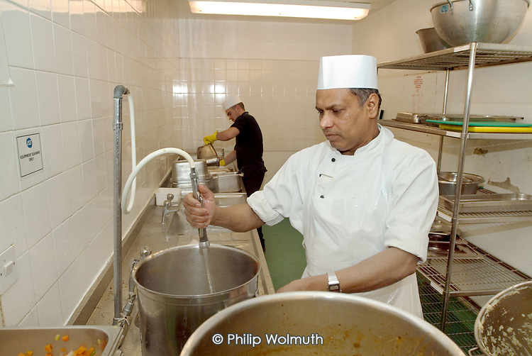 An employee in the kitchen at Homerton Hospital, Hackney, east London, where threatened industrial action by UNISON members employed by multinational ISS Mediclean in catering, portering and cleaning services lead to a deal which took pay from £4.43 to £5.00 an hour (£5.35 from 1 April 2004),  improved annual leave and the introduction of an occupational sick pay scheme.  The claim was part of the Living Wage campaign carried out in partnership with the East London Citizens Organisation (TELCO).