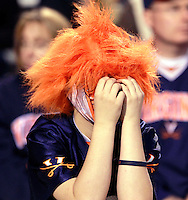 Oct. 22, 2011 - Charlottesville, Virginia - USA; A Virginia Cavaliers fan places his hands to his face during an NCAA football game against the North Carolina State Wolfpack at the Scott Stadium. NC State defeated Virginia 28-14. (Credit Image: © Andrew Shurtleff