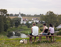 Young people overlooking the town of Suzdal, Russia