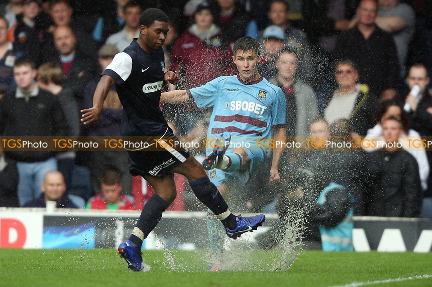 Daniel Potts of West Ham makes a splash with this clearance - Southend United vs West Ham United, Pre-season Friendly at Roots Hall, Southend - 14/07/12 - MANDATORY CREDIT: Rob Newell/TGSPHOTO - Self billing applies where appropriate - 0845 094 6026 - contact@tgsphoto.co.uk - NO UNPAID USE..
