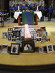 Candles and photos on the altar at the SOSAD mass in the Augustinian church. Photo: Colin Bell/pressphotos.ie
