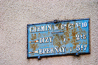 A old street sign in the village indicating the distances to Dizy and to Epernay, the village of Hautvillers in Vallee de la Marne, Champagne, Marne, Ardennes, France
