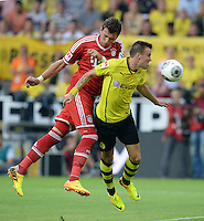 FUSSBALL   1. BUNDESLIGA   SAISON 2013/2014   SUPERCUP Borussia Dortmund - FC Bayern Muenchen           27.07.2013 Mario Mandzukic (li, FC Bayern Muenchen) gegen Kevin Grosskreutz (re, Borussia Dortmund)