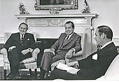 Washington, D.C. - April 26, 1971 -- United States President Richard M. Nixon meets Prime Minister Jack G. Gorton of Australia in the Oval Office of the White House in Washington, D.C. on April 26, 1971.  Pictured from left to right: Prime Minister Gorton; President Nixon; Brigadier General General Alexander M. Haig, Jr., United States Army..Credit: White House via CNP