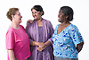 Multiracial group of older women chatting together,
