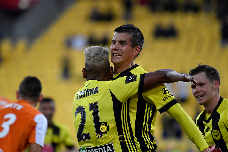 Wellington Phoenix&rsquo; Andrija Kaluderovic and Wellington Phoenix&rsquo; Roy Krishna in action during the A League - Wellington Phoenix v Brisbane Roar FC at Westpac Stadium, Wellington, New Zealand on Saturday 28 October.<br /> Photo by Masanori Udagawa. <br /> www.photowellington.photoshelter.com