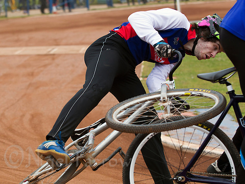 14 JUN 2015 - IPSWICH, GBR - Lewis Roberts of Ipswich Eagles collides with the back wheel of the bike of Hayden Chant of Poole Comets during their Elite League cycle speedway fixture at Whitton Sports and Community Centre in Ipswich, Suffolk, Great Britain (PHOTO COPYRIGHT © 2015 NIGEL FARROW, ALL RIGHTS RESERVED)