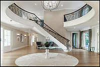 BNPS.co.uk (01202 558833)<br /> Pic: Savills/BNPS<br /> <br /> Three-mendous!<br /> <br /> Impressive atrium.<br /> <br /> Stunning seaside estate overlooking Sandbanks that wouldn't look out of place in the Hollywood Hills - and you get three properties for your &pound;9 million price tag.<br /> <br /> You get three luxury homes for the price of one with this spectacular private coastal estate - but they will still need deep pockets as the trio of properties are on the market for &pound;8.995m.<br /> <br /> The Mulberry House Estate is in the leafy Canford Cliffs area of Poole, Dorset, and has a grand five-bedroom mansion, a second detached five-bedroom house and a two-bedroom gate house.<br /> <br /> Locals describe the Canford Cliffs area as the 'Hollywood Hills' of the coastal property hotspot, more refined and less showy than the more 'Malibu style' Sandbanks peninsula that it overlooks.<br /> <br /> Offering beautiful views but with privacy and seclusion, and without the tourist crowds that the Sandbanks millionaire's enclave attracts.<br /> <br /> Estate agent Savills say the sale is a &quot;unique opportunity&quot; as the 2.2 acre Mulberry property is the only private estate in the area.
